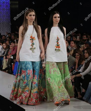 Models present creations by designer Ali Xeeshan during the Fashion Week organized by the Pakistan Fashion Design Council in Lahore, Pakistan