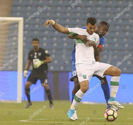 Al-Ahli player Omar Al-Somah (L) in action for the ball with Al-Hilal player Osamah Hawsawi (R) during the Saudi Professional League soccer match between Al-Hilal and Al-Ahli at King Fahad international Stadium in Riyadh, Saudi Arabia, 15 April 2017.