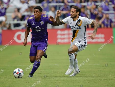 Cristian Higuita, Jermaine Jones Orlando City's Cristian Higuita, left, moves the ball past Los Angeles Galaxy's Jermaine Jones during the first half of an MLS soccer game, in Orlando, Fla