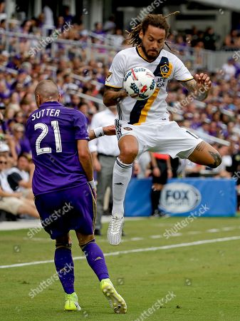 Scott Sutter, Jermaine Jones Los Angeles Galaxy's Jermaine Jones, right, battles with Orlando City's Scott Sutter (21) for possession of the ball during the first half of an MLS soccer game, in Orlando, Fla. Orlando won 2-1