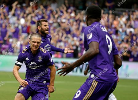 Antonio Nocerino, Will Johnson Orlando City's Will Johnson, right, celebrates after scoring a goal against the Los Angeles Galaxy with teammate Antonio Nocerino, left, during the first half of an MLS soccer game, in Orlando, Fla
