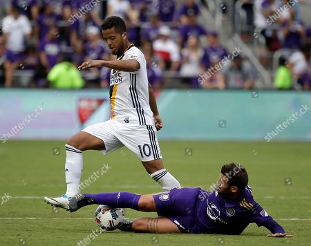 Orlando City's Antonio Nocerino, right, tries to get the ball away from Los Angeles Galaxy's Giovani dos Santos during the second half of an MLS soccer game, in Orlando, Fla. Orlando won 2-1