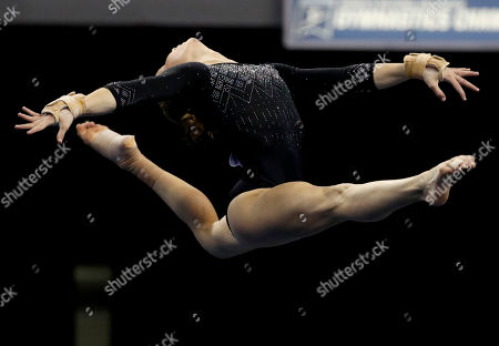 UCLA's Madison Kocian competes in the floor exercise during the NCAA women's gymnastics championships, in St. Louis