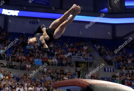 UCLA's Madison Kocian competes on the vault during the NCAA college women's gymnastics championships, in St. Louis