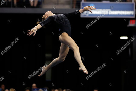 UCLA's Madison Kocian competes on the floor exercise during the NCAA college women's gymnastics championships, in St. Louis