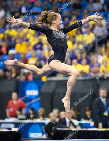 UCLA's Madison Kocian performs on the floor during the Super Six Finals of the NCAA Women's National Collegiate Gymnastics Championships at the Chaifetz Arena in St. Louis, MO
