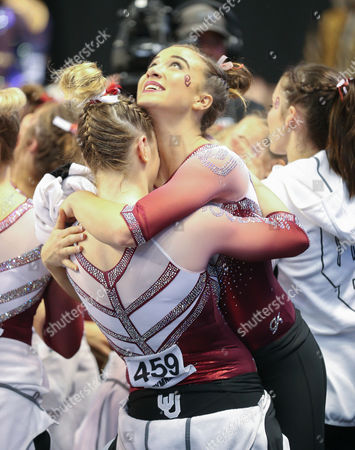 Oklahoma's Natalie Brown hugs Nicole Lehrmann at the end of the Super Six Finals of the NCAA Women's National Collegiate Gymnastics Championships at the Chaifetz Arena in St. Louis, MO