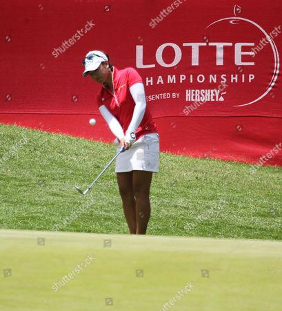 Mina Harigae chips onto the 18th green during action at the LPGA LOTTE Championship at the Ko Olina Golf Club in Kapolei, HI. - Michael Sullivan/CSM