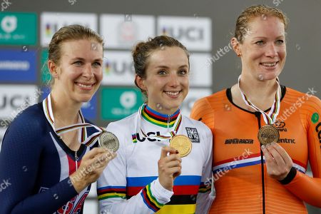 Great Britain's Elinor Barker, centre, celebrates on the podium after winning the women's points race with second placed United States' Sarah Hammer, left, and third placed Kirsty Wild of the Netherlands at the World Track Cycling championships in Hong Kong