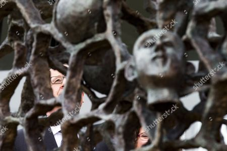 Stock Picture of French President Francois Hollande stands behind a sculpture by German born and French artist Haim Kern entitled 'They didn't choose their tomb' during the commemorations of the Chemin des Dames battle for its 100th anniversary at the Caverne du Dragon near Cerny en Laonnois, France, 16 April 2017. 187000 French soldiers and 163000 German soldiers died during the Chemin des Dames battle.