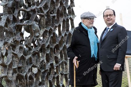 Stock Photo of French President Francois Hollande (R) and German born and French artist Haim Kern stand before the sculpture entitled 'They didn't choose their tomb' during the commemorations of the Chemin des Dames battle for its 100th anniversary at the Caverne du Dragon near Cerny en Laonnois, France, 16 April 2017. 187000 French soldiers and 163000 German soldiers died during the Chemin des Dames battle.