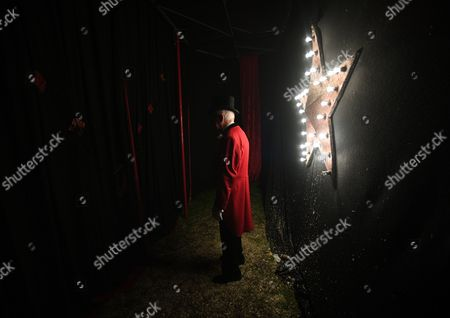 Ringmaster, Norman Barrett awaits to start the show during the Zippos Circus show in Blackheath in London, Britain, 14 April 2017. Their latest show, 'Jigit!' showcases a wide range of acts from knife throwing, and swinging trapeze, to Cossack horse riders from Kahzakstan and motorcycle daredevils from Brazil. The Zippos is one of Britain's favorite family circus and has been touring the United Kingdom for more than 30 years.