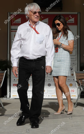 Formula One former boss Bernie Ecclestone, is flanked by his wife Fabiana Flosi, prior to the start of the Bahrain Formula One Grand Prix, at the Formula One Bahrain International Circuit in Sakhir, Bahrain