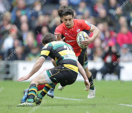 Alex Lozowski of Saracens goes past Lee Dickson of Northampton