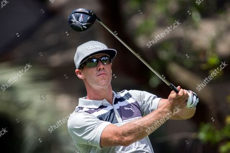 Graham DeLaet, of Canada, watches his drive down the second fairway during the final round of the RBC Heritage golf tournament in Hilton Head Island, S.C