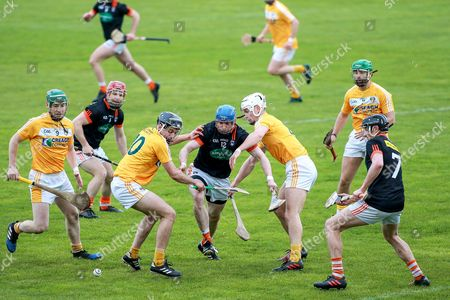 Armagh vs Antrim. Armagh's Conor Corvan in action against Antrim's Maol Connolly and Stephen Rooney