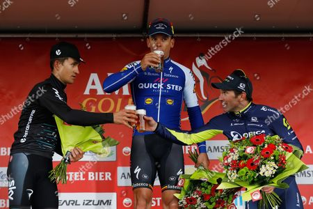 Philippe Gilbert (C) celebrates his victory with second placed Michal Kwiatkowski (L) and Michael Albasini who finished third during the Amstel Gold Race in Beek, Netherlands, 16 April 2017.