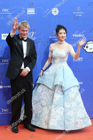 Stock Picture of Music producer Marius de Vries (L) and Chinese singer Sa Dingding arrive for the opening ceremony red carpet event of the 7th Beijing International Film Festival in Beijing, China, 16 April 2017. The film festival runs from 16 to 23 April.
