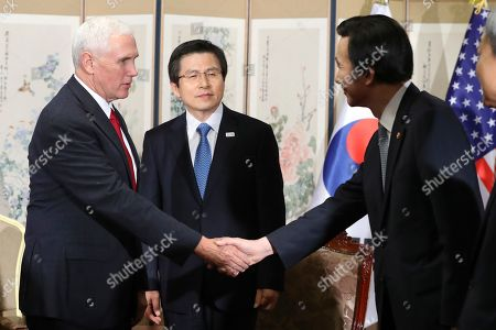 """Mike Pence, Hwang Kyo-ahn, Hwang Kyo-ahn U.S. Vice President Mike Pence, left, shakes hands with South Korean Foreign Minister Yun Byung-se as South Korea's acting President and Prime Minister Hwang Kyo-ahn, center, stands prior to a meeting in Seoul, South Korea, . Pence declared Monday the """"era of strategic patience is over"""" with North Korea, expressing impatience with the unwillingness of the regime to move toward ridding itself of nuclear weapons and ballistic missiles"""