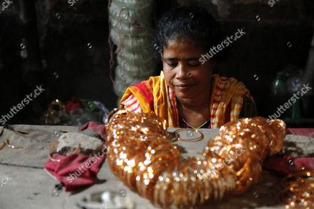 Editorial photo of Women working in a bangle factory in Dhaka, Bangladesh - 17 Apr 2017