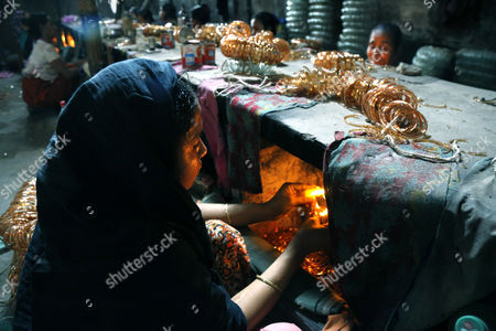 Editorial image of Women working in a bangle factory in Dhaka, Bangladesh - 17 Apr 2017