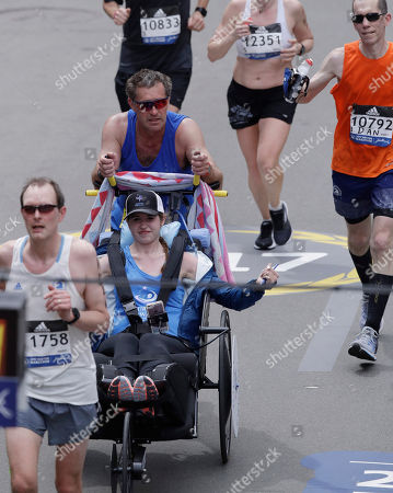 Bobby Carpenter, Denna Laing Bobby Carpenter, pushes Denna Laing across the finish line in the 121st Boston Marathon, in Boston. Carpenter was the first American-born player to be taken in the first round of an NHL Draft. Laing has been wheelchair-bound since being injured in the 2015 Women's Winter Classic hockey game