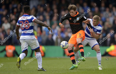 Adam Reach of Sheffield Wednesday with Jake Bidwell and Kazenga Lualua of QPR (r) during the Sky Bet Championship match between Queens Park Rangers and Sheffield Wednesday played at Loftus Road, London on 17th April 2017