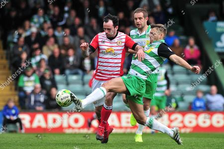 Ryan Dickson of Yeovil Town battles for the ball with Chris Dagnall of Crewe Alexandra during the Skybet League 2 Match between Yeovil Town and Crewe Alexandra at Huish Park, Yeovil, Somerset on April 17.