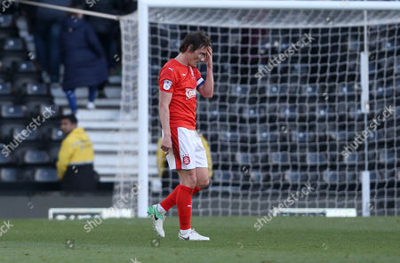 Huddersfield Town's Dean Whitehead walks off a dejected figure at the final whistle during the Sky Bet Championship match between Derby County and Huddersfield Town played at The iPRO stadium, Derby on 17th April 2017