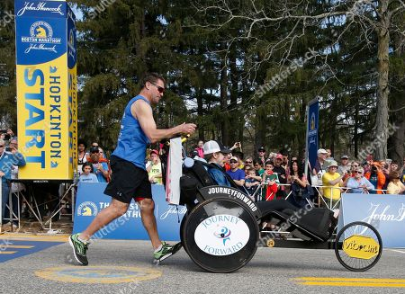 Stock Picture of Bobby Carpenter, Denna Laing Bobby Carpenter, pushes Denna Laing at the start of the 2017 Boston Marathon in Hopkinton, Mass., . Carpenter was the first American-born player to be taken in the first round of an NHL Draft. Laing has been wheelchair-bound since being injured in the 2015 Women's Winter Classic