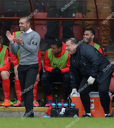 Omer Riza (left) the Leyton Orient manager claps
