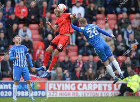 Paul McCallum of Leyton Orient wins a header above Scott Harrison of Hartlepool United