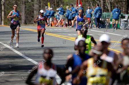 Luke Puskedra, Meb Keflezighi, Jared Ward Luke Puskedra, left, Meb Keflezighi and Jared Ward, all of the United States, run behind the leaders in the 121st Boston Marathon, in Natick, Mass