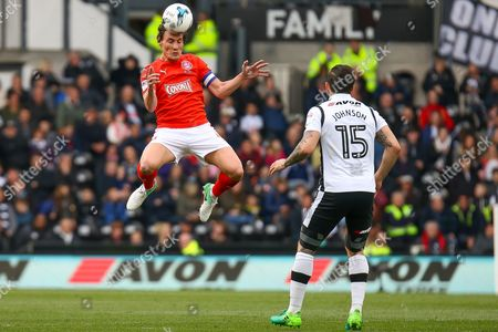 Huddersfield midfielder Dean Whitehead heads the ball during the EFL Sky Bet Championship match between Derby County and Huddersfield Town at the Pride Park, Derby