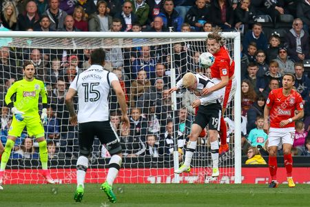 Huddersfield midfielder Dean Whitehead clears the ball in the box during the EFL Sky Bet Championship match between Derby County and Huddersfield Town at the Pride Park, Derby