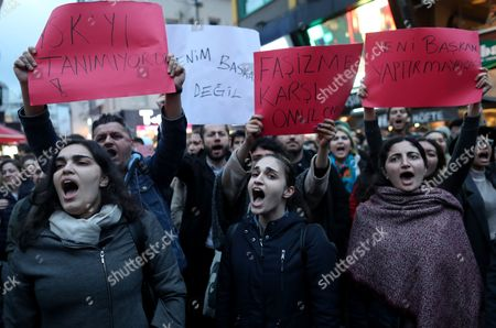 Protesters shout slogans  and hold placards reading 'You are not my president' and 'We will never be a president', during a rally against the referendum results in Istanbul, Turkey, 17 April 2017. Media reports Turkish President Erdogan won a narrow lead of the 'Yes' vote in unofficial results, 17 April 2017. The proposed reform, passed by Turkish parliament on 21 January, would change the country's parliamentarian system of governance into a presidential one, which the opposition denounced as giving more power to Turkish President Erdogan.