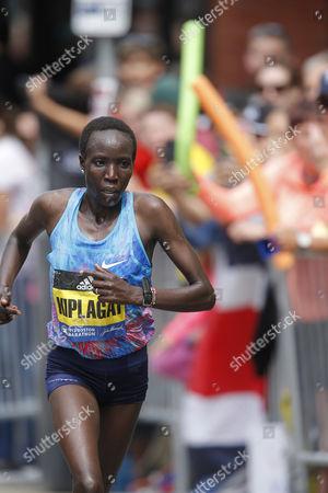 Edna Kiplagat of Kenya runs to win the Womens Division of the 121st Boston Marathon in Boston, Massachusetts, USA 17  April 2017.
