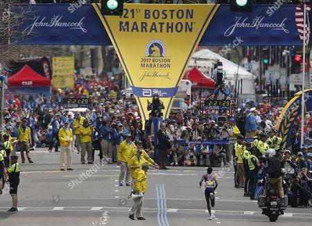 Edna Kiplagat of Kenya runs to the finish line to win the Womens Division of the 121st Boston Marathon in Boston, Massachusetts, USA 17 April 2017.