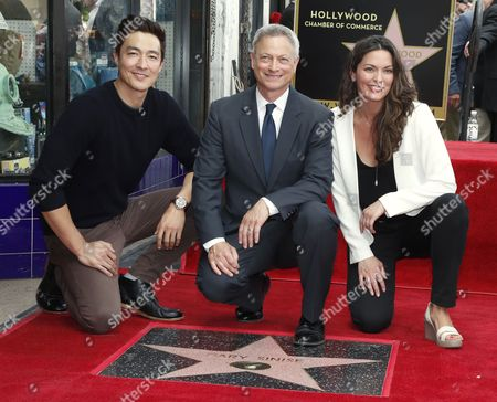 US actors Daniel Henney (L) and Alana De La Garza (R) join US actor/director Gary Sinise (C) to pose with Sinise's star on the Hollywood Walk of Fame during ceremony in Hollywood, California, USA, 17 April 2017. Sinise received the 2,606th star on the Walk of Fame in the category of Television.