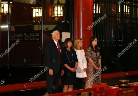 Mike Pence, Karen Pence, Audrey Pence, Charlotte Pence U.S. Vice President Mike Pence, left, and his wife Karen, second from left, with their daughters Audrey, right, and Charlotte, third from right, visit the main shrine of Sensoji Buddhist temple in Tokyo