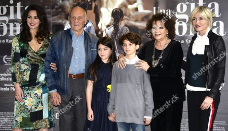 (L) Italian filmmaker Karin Proia with (L-R) actors cast/members Philippe Leroy, Tea Buranelli, Libero Natoli, Claudia Cardinale and Chiara Conti, pose for photographs during a photo call for the movie 'Una gita a Roma' (A trip to Rome)