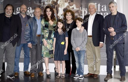 Italian filmmaker and actress Karin Proia (L-4) poses with cast members during a photo call for the movie 'Una gita a Roma' (A trip to Rome)