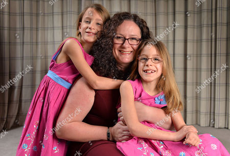Stock Image of Seven Year Old Disabled Girl Rebecca Carey (r) Pictured With Her Mum Pamela And Sister Charlotte At Their Home In Congleton Cheshire. Rebecca Needs Selective Dorsal Rhizotomy (sdr) Surgery In The Usa To Walk Again And Is Appealing To Dm Readers For Help.