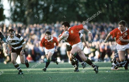 Will Carling - Lions centre and captain against Hawke's Bay is supported by Stuart Barnes and Richard Webster (R). Hawke's Bay v British & Irish Lions, McLean Park, Napier, New Zealand, 22nd June 1993