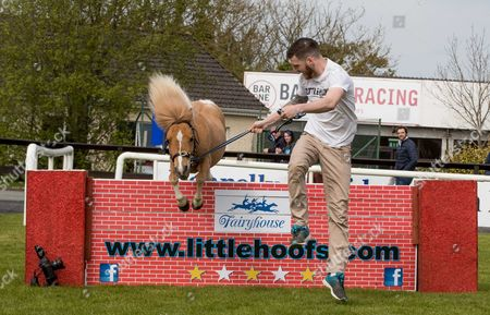 Stock Picture of Daniel Kennedy with Flash clears the wall in an exhibition of jumping by falabella horses at Fairyhouse today
