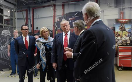 Donald Trump, Nicholas T. Pinchuk, Scott Walker President Donald Trump tours the headquarters of tool manufacturer Snap-on Inc. with Chief Executive Officer Nicholas T. Pinchuk, second from right, in Kenosha, Wis.,. From left are, Treasury Secretary Steven Mnuchin, Education Secretary Betsy DeVos, the president, Pinchuk and Senator Ron Johnson, R-Wis