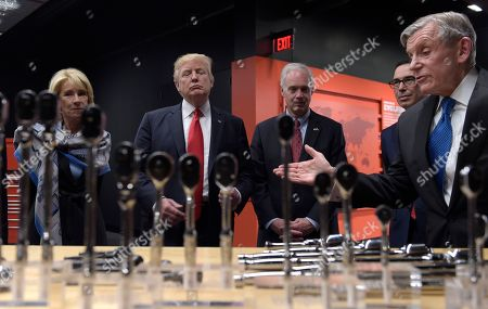 Donald Trump, Nicholas T. Pinchuk, Scott Walker President Donald Trump tours the headquarters of tool manufacturer Snap-on Inc. with Chief Executive Officer Nicholas T. Pinchuk, right, in Kenosha, Wis., Tuesday, April 18, 2017. From left are, Education Secretary Betsy DeVos, the president, Senator Ron Johnson, R-Wis., Treasury Secretary Steven Mnuchin and Pinchuk