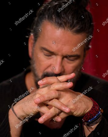 "Guatemalan singer-songwriter Ricardo Arjona listens to a question during an interview with The Associated Press in Miami. Arjona is releasing ""Circo Soledad,"" an album that makes analogies between the circus, politics and real life"