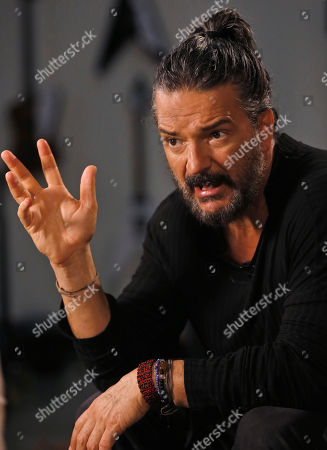 "Guatemalan singer-songwriter Ricardo Arjona gestures as he speaks during an interview in Miami. Arjona is releasing ""Circo Soledad,"" an album that makes analogies between the circus, politics and real life"