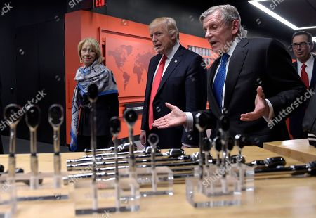 Donald Trump, Nicholas T. Pinchuk, Betsy DeVos, Steven Mnuchin President Donald Trump listens as Snap-on Inc., Chief Executive Officer Nicholas T. Pinchuk, second from right, speaks during a tour of at the company headquarters in Kenosha, Wis.,. Trump visited the headquarters of tool manufacturer Snap-on Inc., and signed an executive order that seeks to make changes to a visa program that brings in high-skilled workers. Education Secretary Betsy DeVos, left, and Treasury Secretary Steven Mnuchin, right, also listen
